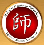 Logo of the North American Association of Japanese Karate Masters - The large character in the middle is SHI, the Japanese word for Master.